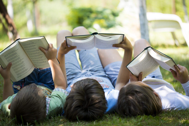 Three children reading in the garden